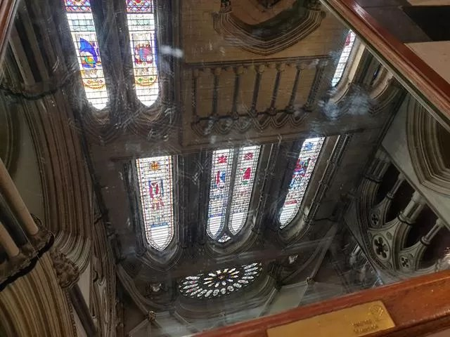 mirror reflection of york minster ceiling