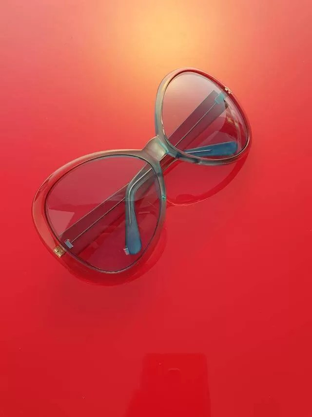 red sunglasses on red background