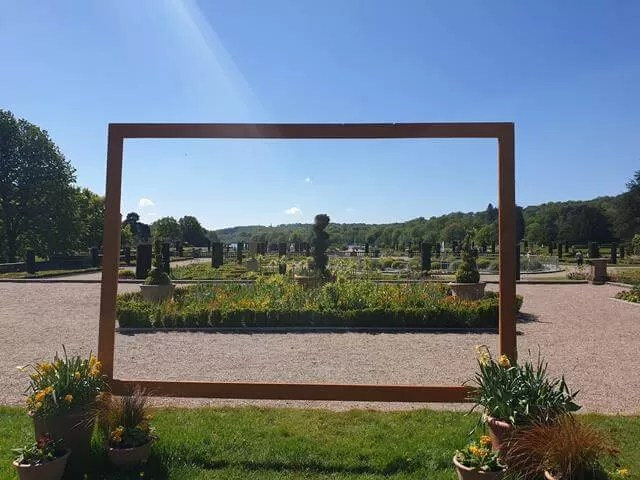 view of the gardens through a frame