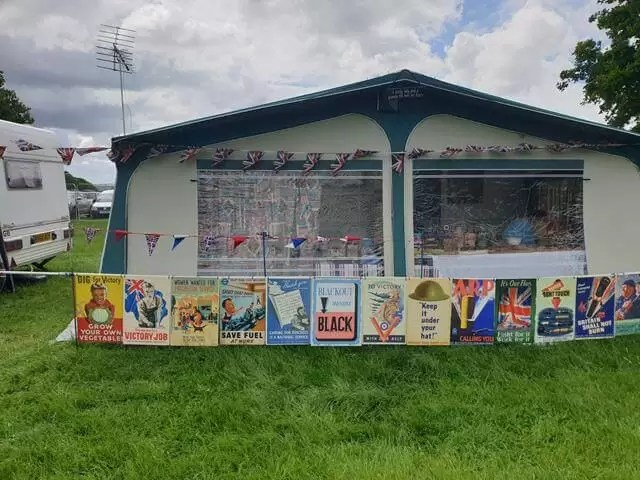 caravan awning with posters outside