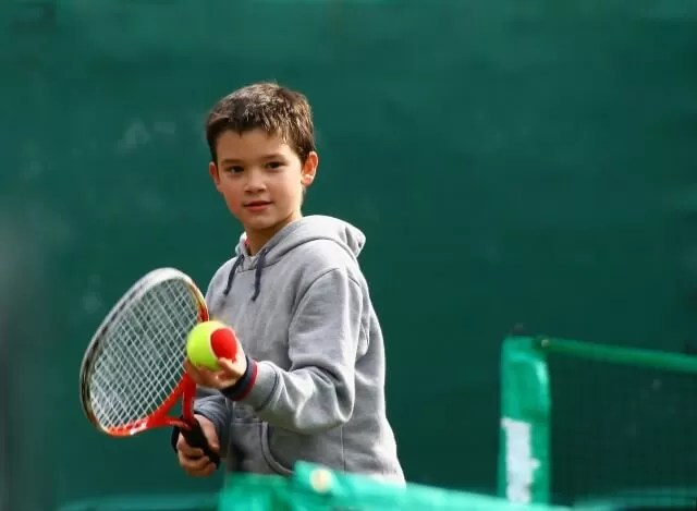 mini tennis playing boy
