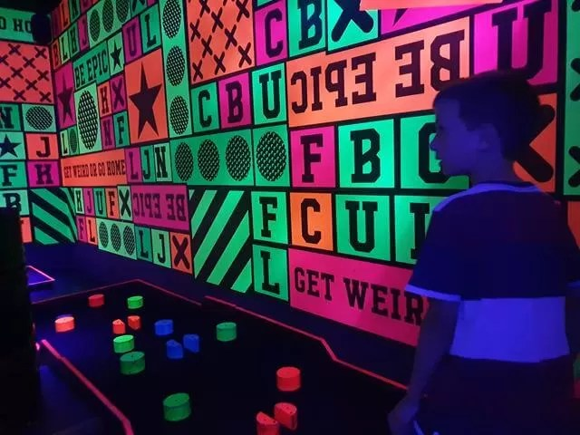 neon junkyard golf wall