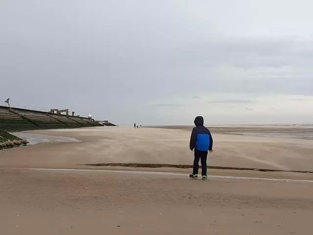 lone boy on blackpool beach