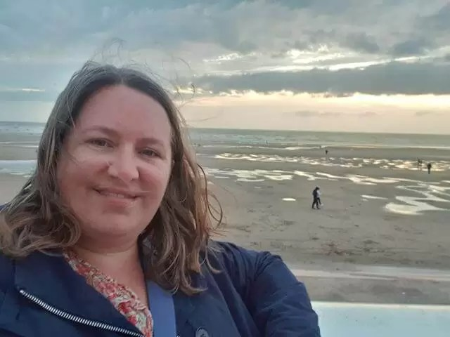 selfie overlooking the beach at sunset