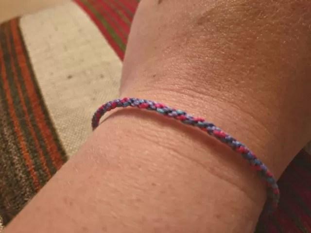friendship bracelet the easy way in purples.
