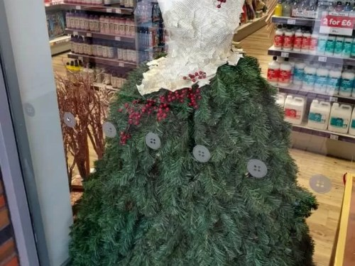 hobbycraft dress made out of fir branches and berries