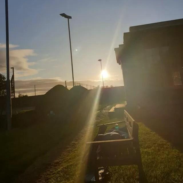sunset over tennis pavilion