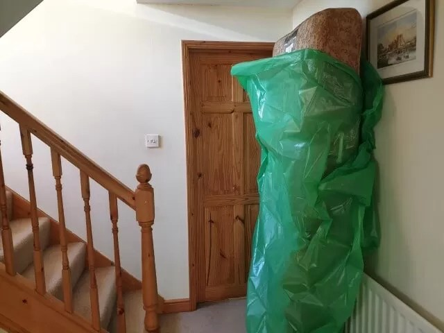 getting rid of the old mattress in its recycling bag