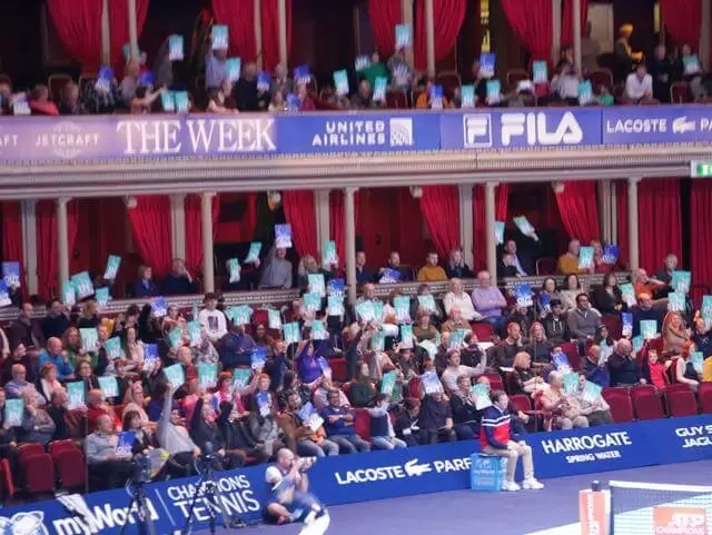 crowd at royal albert hall showing their in or out cards