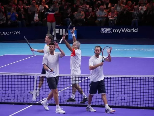doubles players walking off court at the end of he match