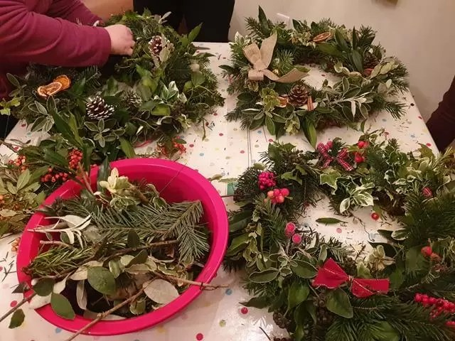 finished wreaths on table at wreath making workshop