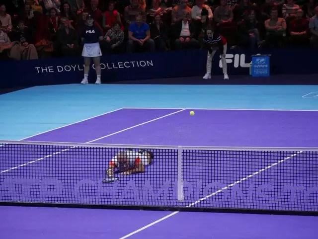 mansour bahrami playin tennis lying on the floor