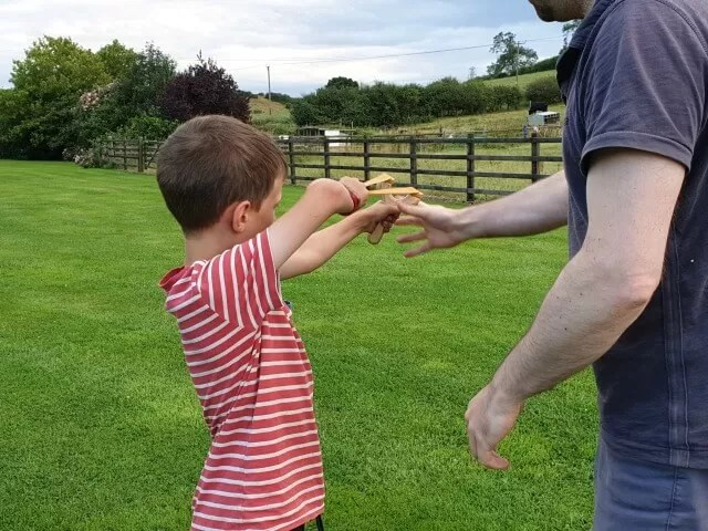 uncle and nephew playing catapults