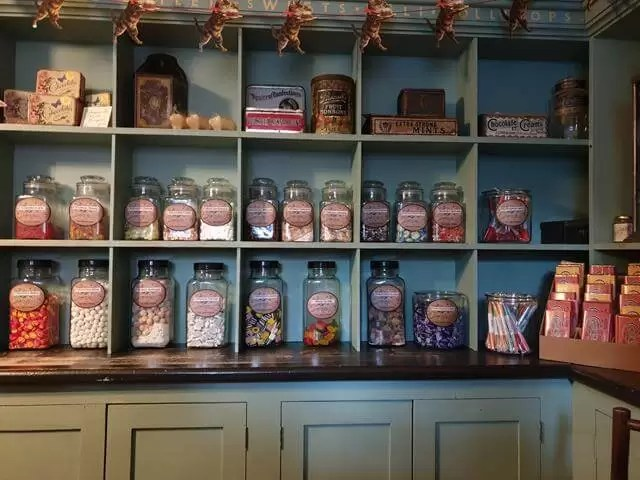 pretty grocery displays in victorian shop