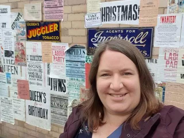 selfie alongside some old posters