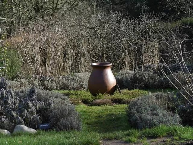 pot in the middle of the vegetable garden