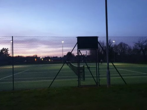 tennis courts under floodlighting