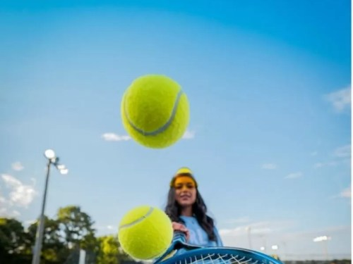 Being tennis captain and what it means, woman bouncing tennis balls on racket