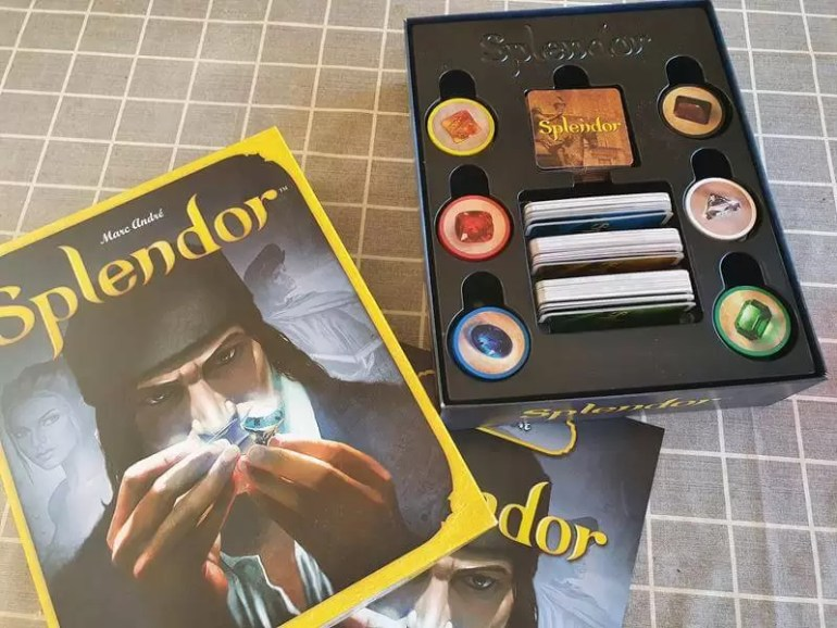 Splendor game box and game pieces