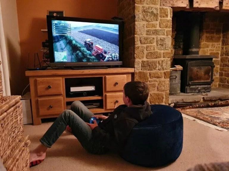 comfy on the floor playing farming simulator