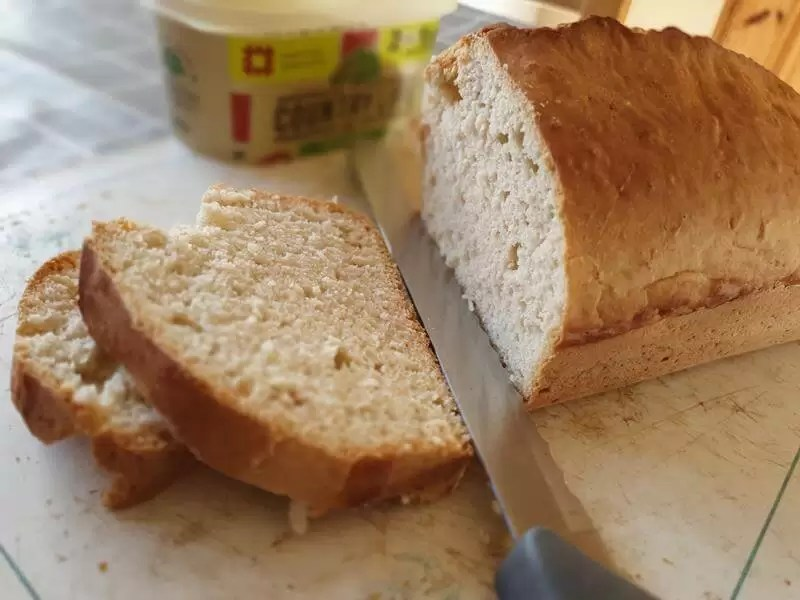 beer bread sliced with knife and butter pack
