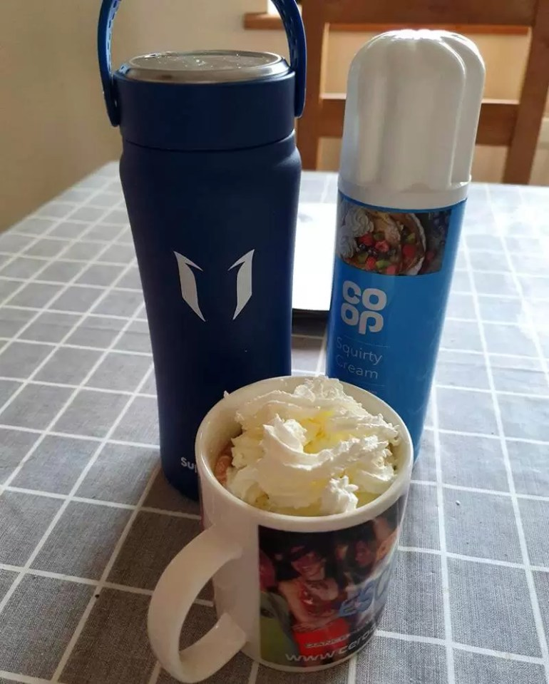 insulated stainless steel flask with hot chocolate and cream