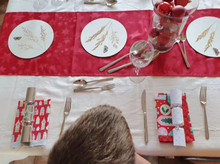 table set for christmas shot from above