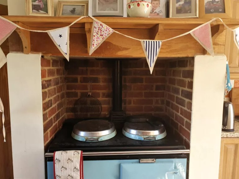 homemade bunting hung above a turquoise aga