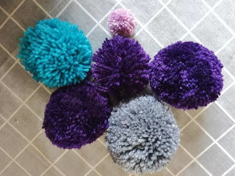 large and 1 small mixture of pom poms