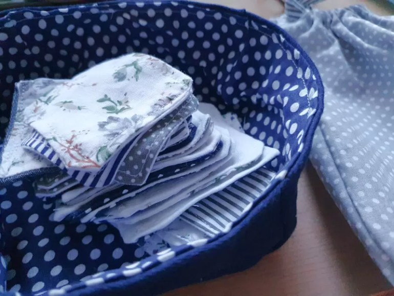 reusable face wash pads and fabric basket for storage