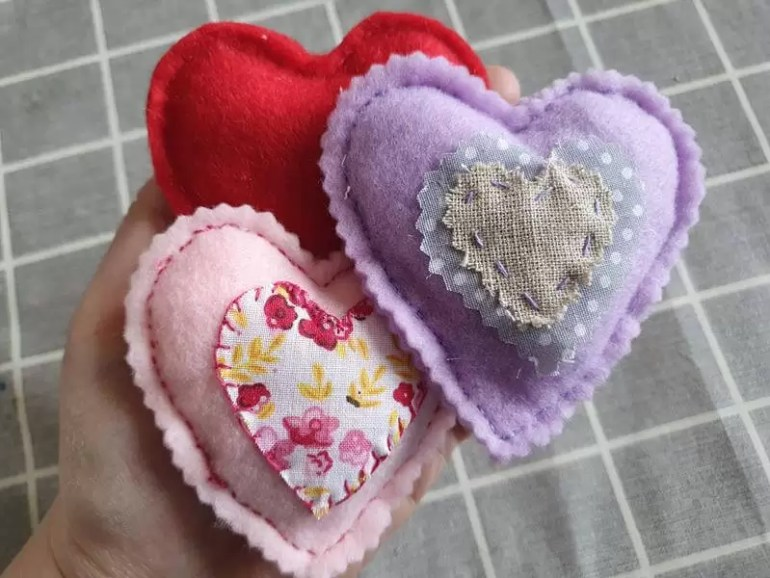 3 multicoloured felt stuffed hearts