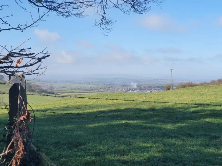 View from the top of the hill above Warwickshire looking down the valley to the village