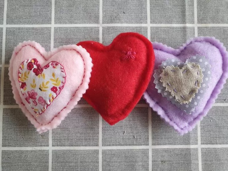 row of 3 homemade stuffed felt hearts