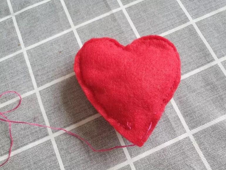 stuffed red felt heart