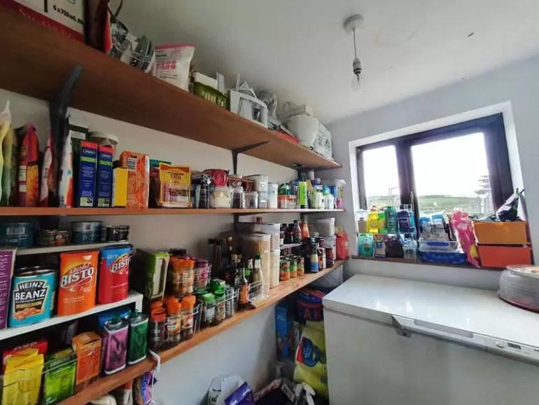 fully organised shelves in larder