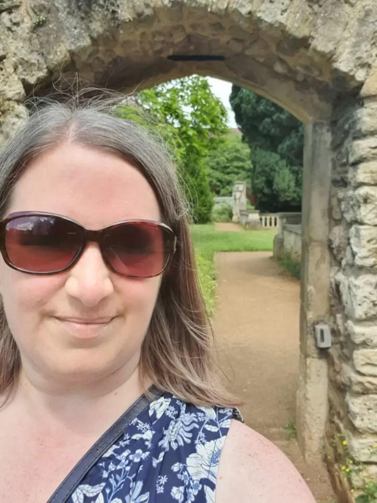 selfie under stone arch in abbey gardens