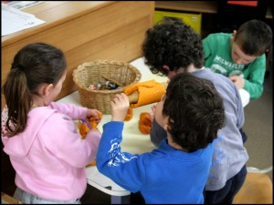 pre school kids using play dough