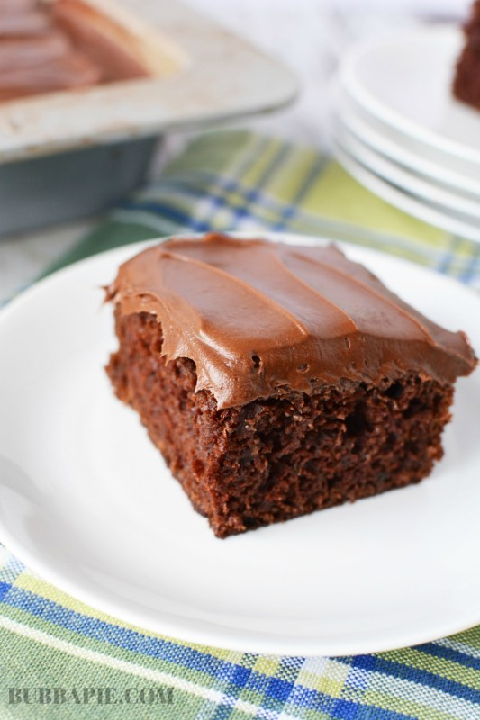 A slice of Chocolate Zucchini Cake on a white plate