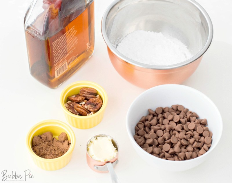 Bourbon Balls Recipe includes crushed pecans, chocolate chips, butter and sugar