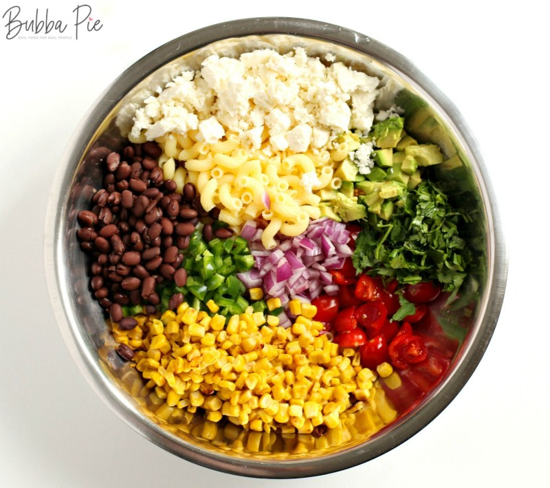 Mexican Street Corn Pasta Salad includes corn, black beans, avocado, macaroni and tomatoes
