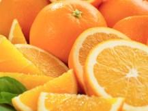 Freshly Sliced Oranges --- Image by © Lew Robertson/Corbis