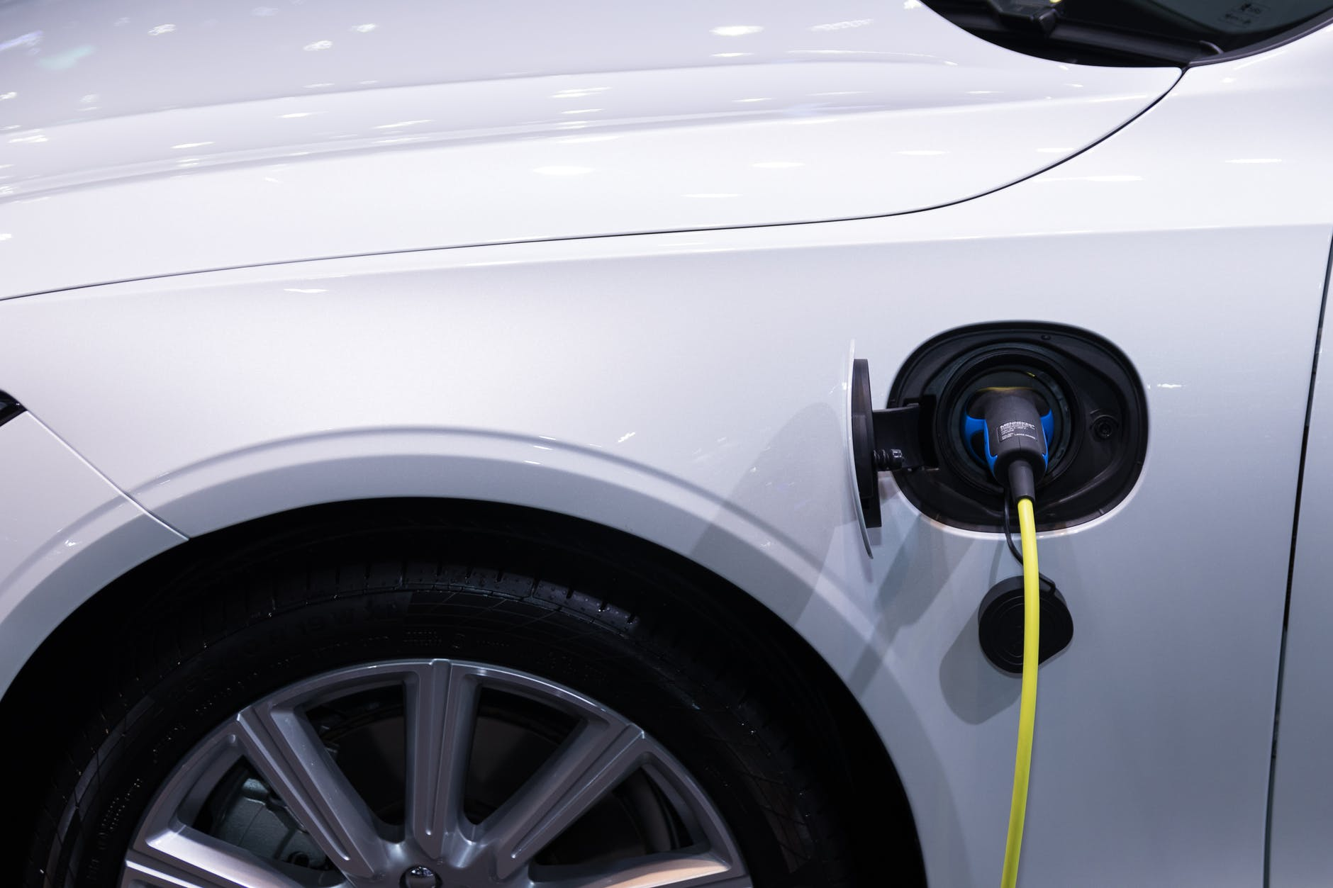 An electric car is charging its battery