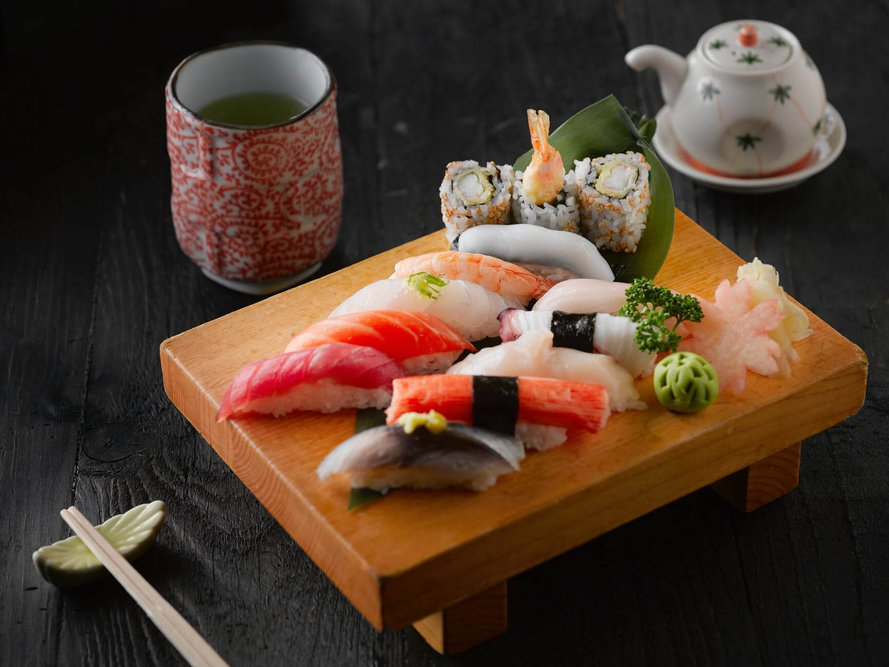 Japanese sushi on brown wooden board