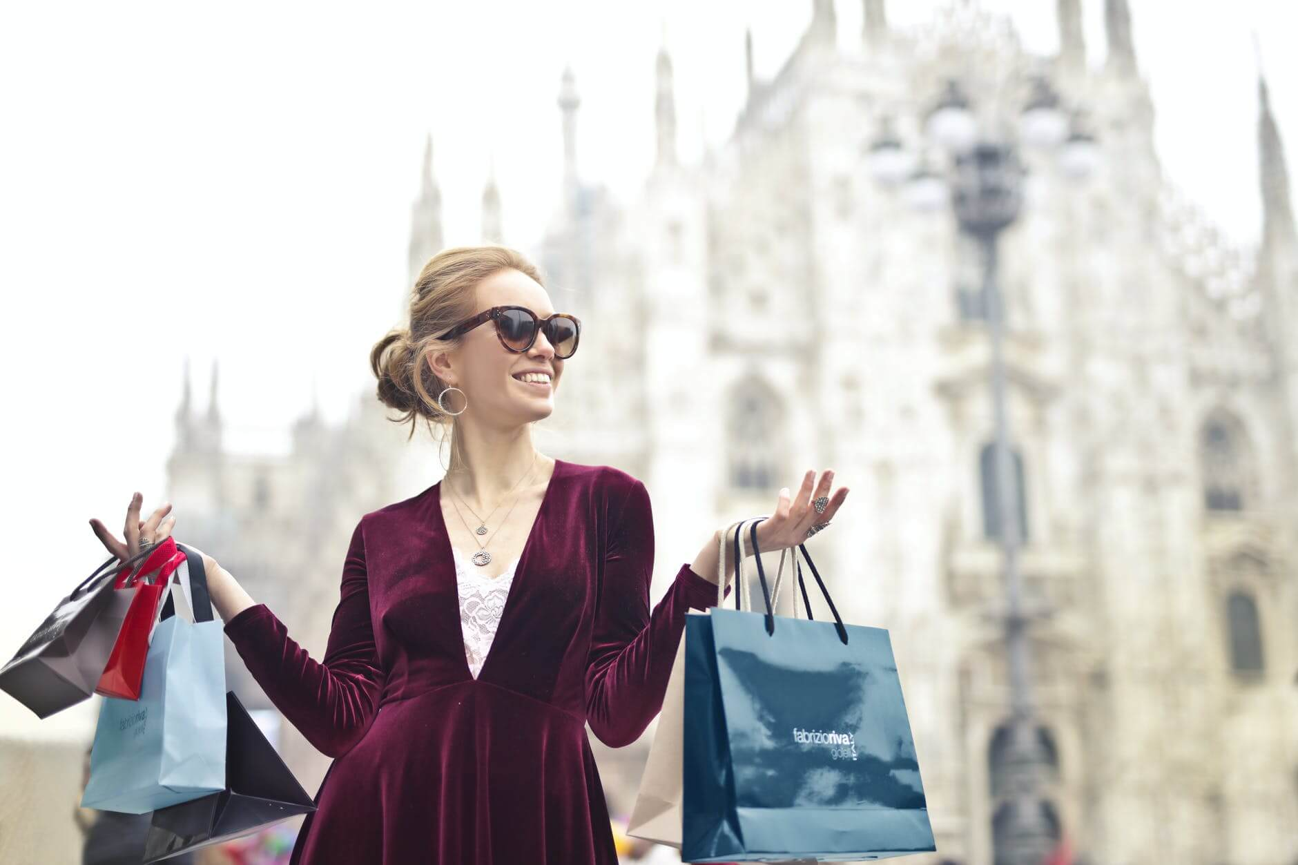 A women has bought numerous bags of luxury goods