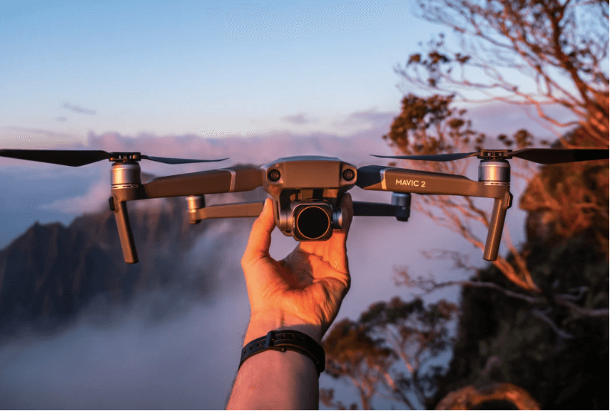 A man is holding a drone