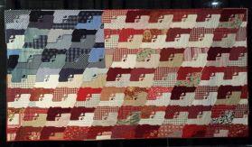 le drapeau américain représenté avec des armes et confectionné avec des restes d'uniformes