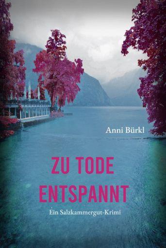 Das Cover zeigt einen See, umrahmt von roten Bäumen, im Hintergrund Berge