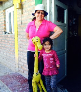 Grandma and little girl with giraffe friend at remote Hostel