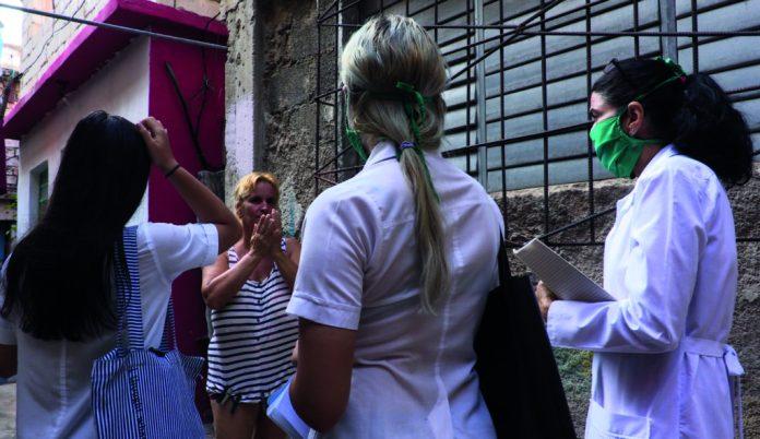 Cuban doctor Liz Caballero and two medical students go door-to-door looking for possible cases of Covid-19 in Havana in March 2020. (Adalberto Roque/AFP via Getty Images)