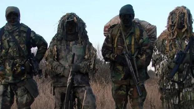Esta foto de archivo muestra cuatro integrantes del Grupo Alacrán